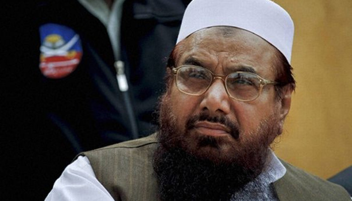 Hafiz Saeed a serious threat, put under house arrest in country's larger interest: Pakistan Defence Minister